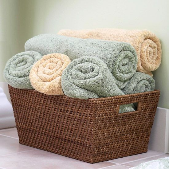 a wicker basket is a timeless solution that will make any bathroom cozier