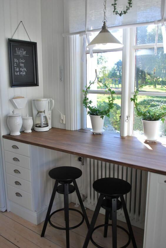 a windowsill used as a breakfast zone, additional drawers for storage
