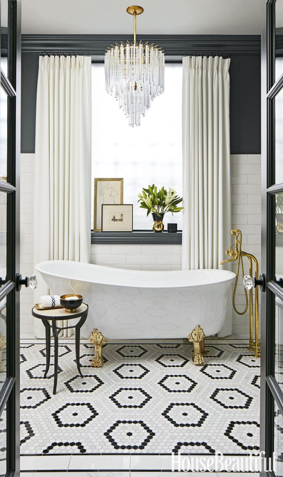 Spectacular an art deco bathroom in graphite grey and cream and a large crystal chandelier