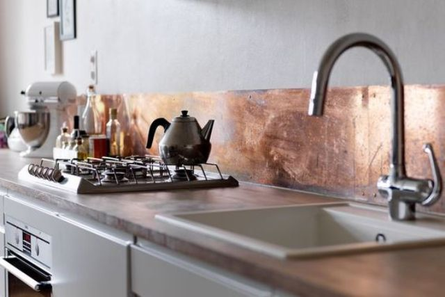 copper sheet backsplash looks unique and very eye-catchy plus it's not expensive