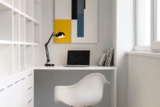 15 ultra-minimalist home office with a large built-in sheving unit and a floating desk