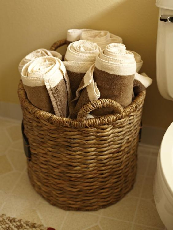 a wicker basket with towels is a cozy touch for any bathroom