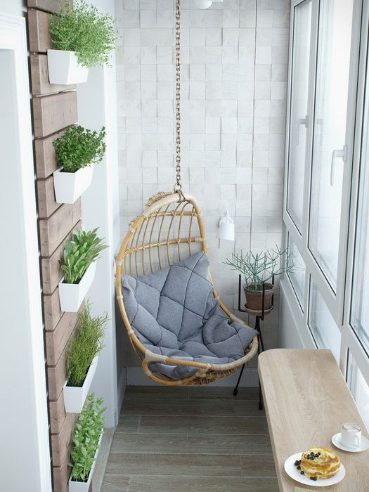 a wicker hanging chair with a cushion and a breakfast nook with a foldable table