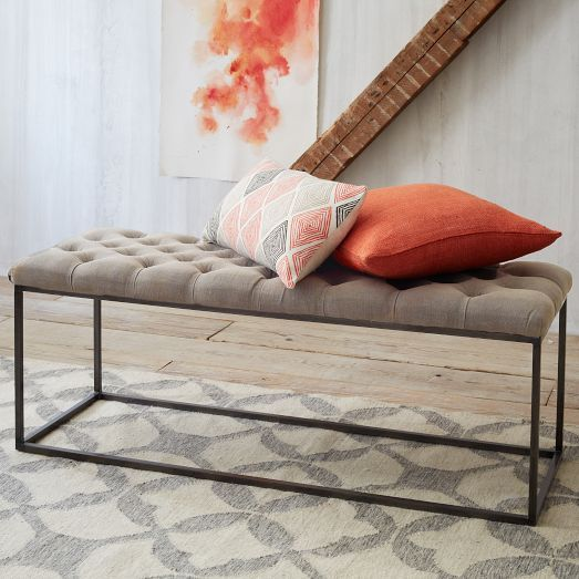 an upholstered bench on metal framing is a perfect solution for any entryway and it doesn't look bulky