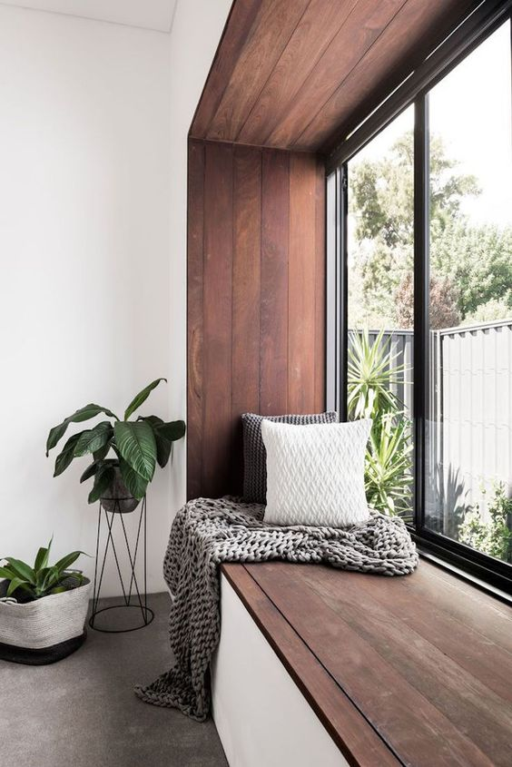 enjoy the views turning your window sill into a comfy seating with pillows