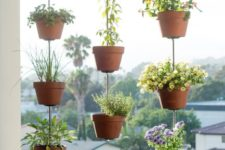 16 suspended planters on the balcony is a creative and cool idea