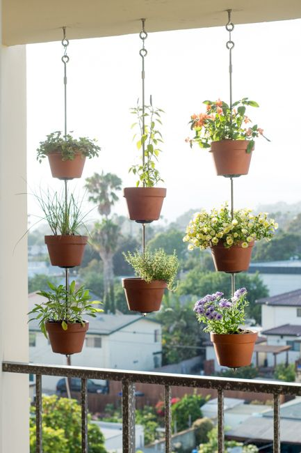 suspended planters on the balcony is a creative and cool idea