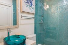 16 turquoise glass sink makes a colorful statement in the coastal bathroom