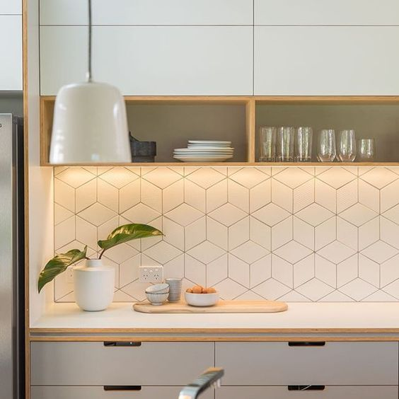 white geo tiles backsplash brings a modern feel to the kitchen