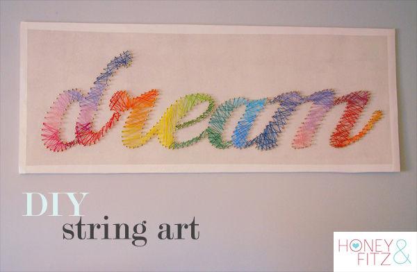 DIY rainbow colored string art piece