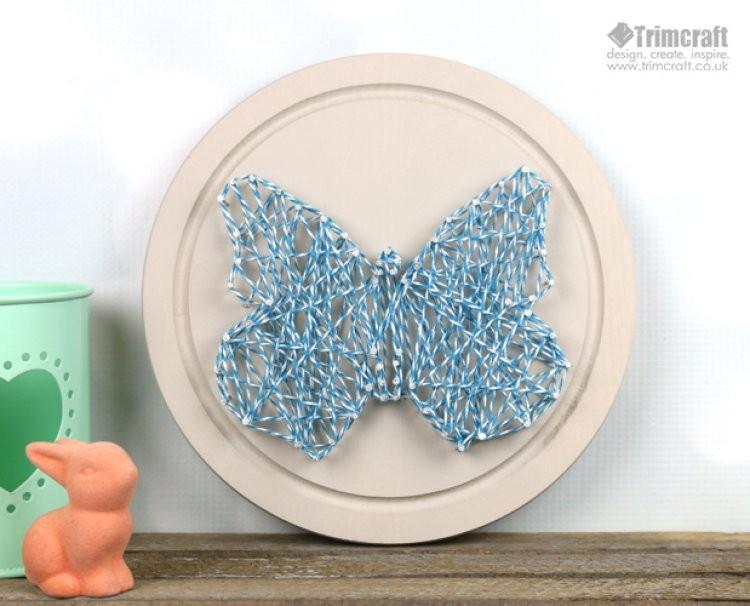 DIY butterfly string art piece (via www.shelterness.com)