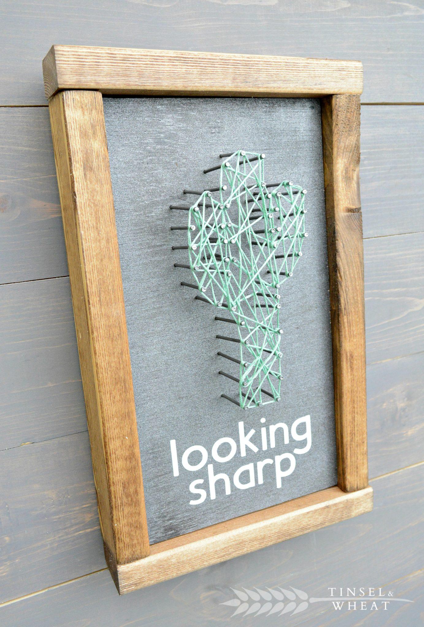 DIY looking sharp cactus string art piece
