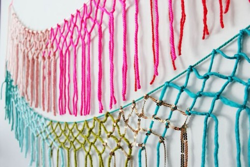 DIY colorful macrame and fringe wall hanging (via www.shelterness.com)