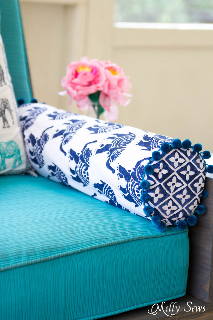 DIY bolster pillow with pompom trim (via mellysews.com)