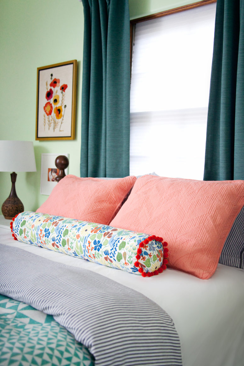 bright DIY bolster pillow for a summer bedroom (via abeautifulmess.com)