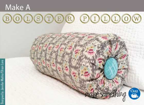 DIY bolster pillow with a decorative button (via makesomething.dritz.com)