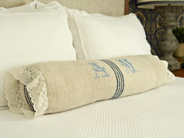 DIY rustic and coastal bolster pillow with lace (via www.hgtv.com)