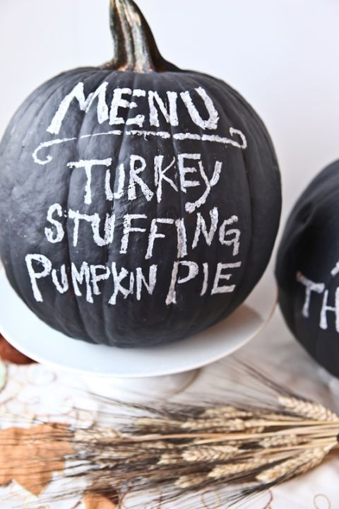 a chalkboard pumpkin used as a menu for your party