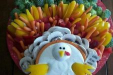 02 a cute turkey-shaped veggie tray with various veggies and dip styled as a bird