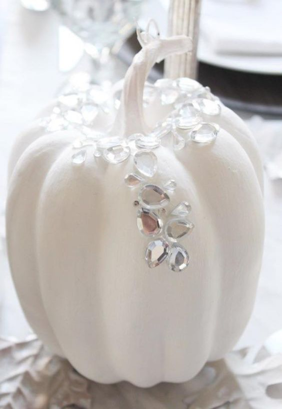 a glam Halloween pumpkin topped with large rhinestones to sparkle