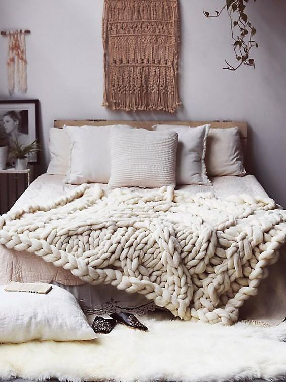 a gorgeous white chunky knit blanket for a boho chic bedroom