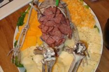 02 a skeleton filled with salami and different kinds of cheese is a scary idea for an adult party