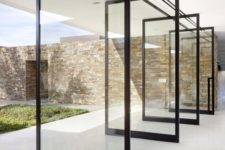 02 the whole wall is made of pivot doors, which create a strong indoor-outdoor connection