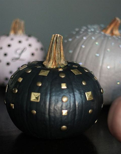 a black matte pumpkin with gold studs is a chic and easy DIY for this Halloween