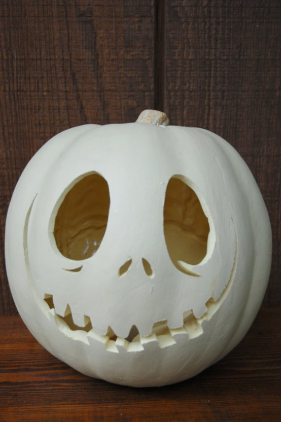 a carved faux pumpkin painted white looks cool and unusual