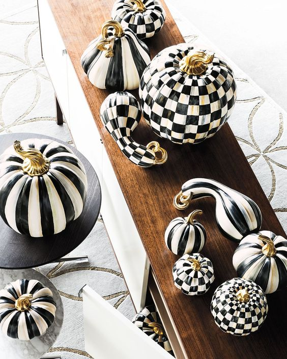 a modern pumpkin display in black and white, with stripes and check patterns