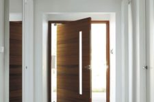 03 this stunning western, red cedar, pivoting door creates a real focal point in the hallway