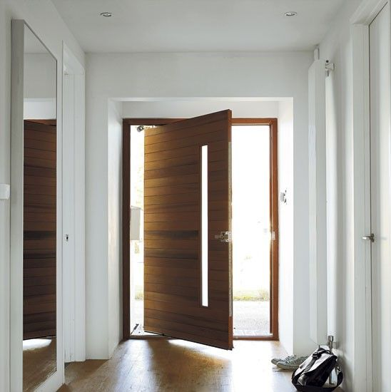 this stunning western, red cedar, pivoting door creates a real focal point in the hallway