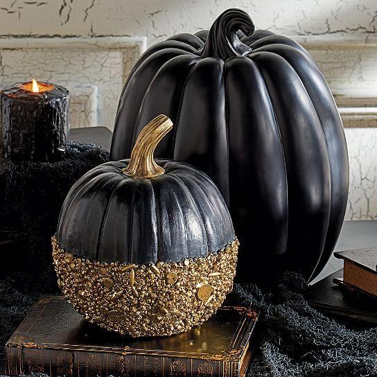 a black pumpkin and a black gold glitter pumpkin for chic halloween decor - Chic Halloween Decor