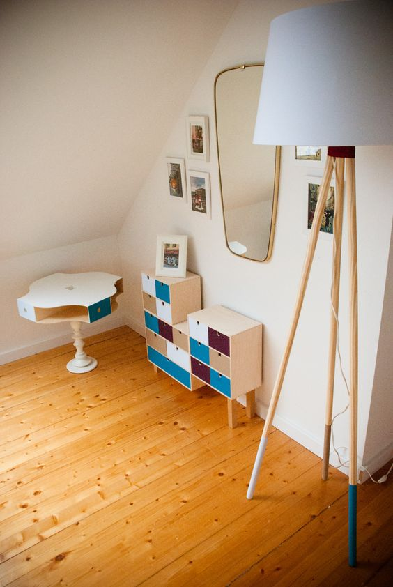a colorful sideboard with a matching table is great for any entryway