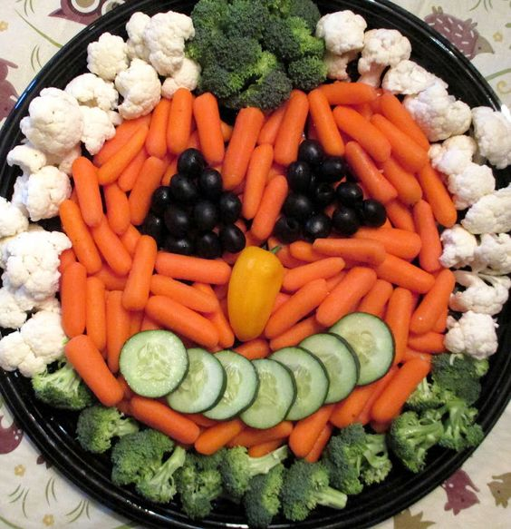 a fun veggie tray with a face looks creative and will inspire your kids eating