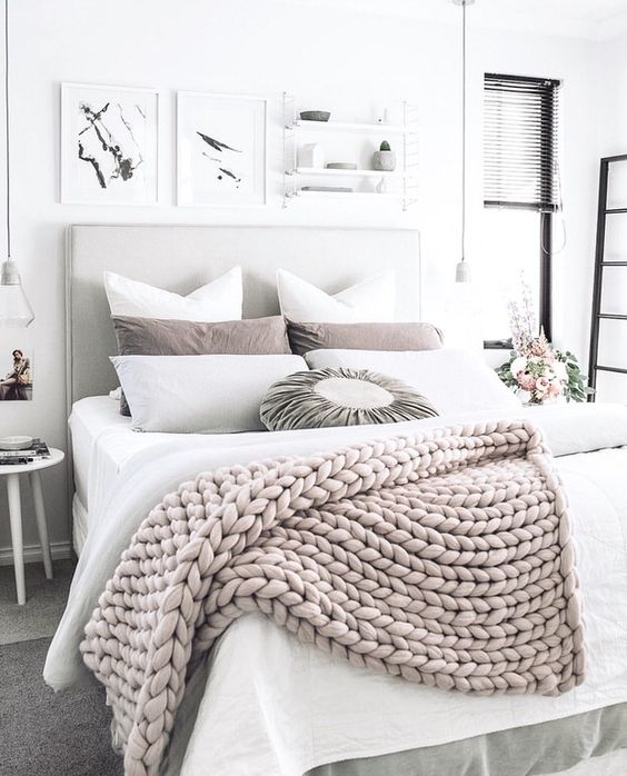 a neutral chunky knit blanket will easily fit most of bedroom styles and colors