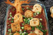 04 graveyard taco dip looks cute and is easy to make for your party