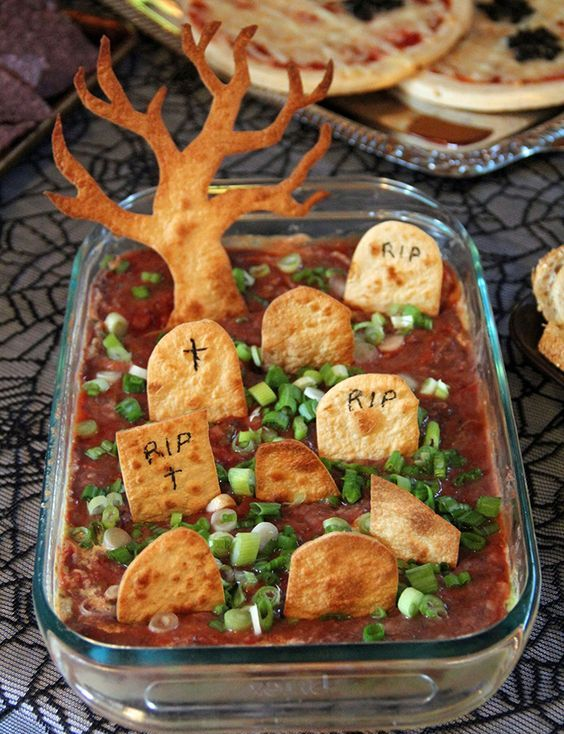 graveyard taco dip looks cute and is easy to make for your party