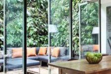 04 pivoting glass doors connects the indoor dining area and outdoor living room
