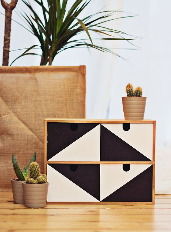 a geometric black and white Ikea Moppe for keeping your desk in order