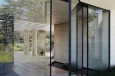 05 a modern black framed pivot glass door is a gorgeous idea to emphasize the entry