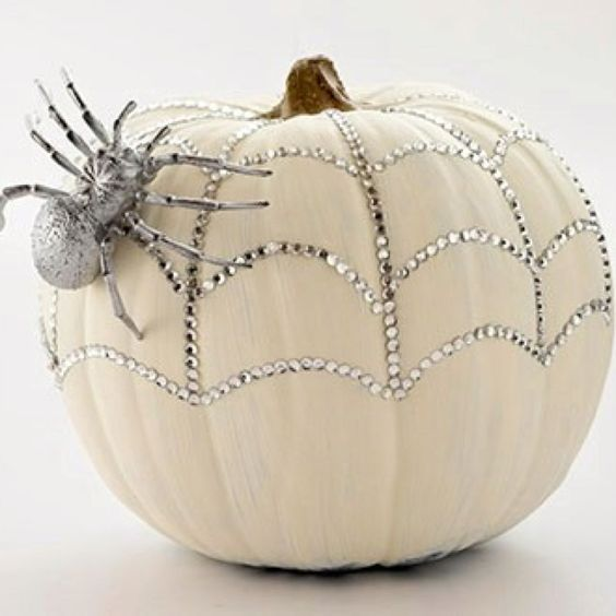 a sparkling pumpkin with rhinestones and a a silver spider for a glam feel