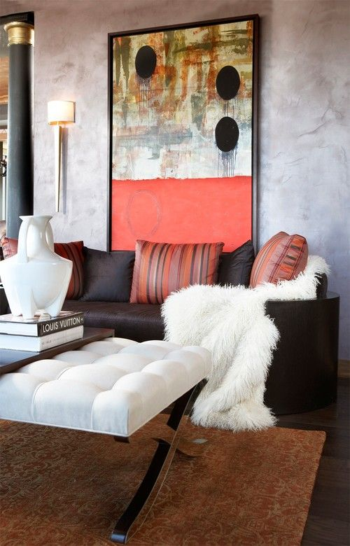 a white faux fur blanket adds a luxurious feel to this living room