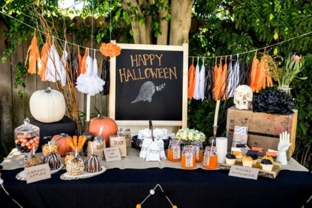 traditional black and orange decor with a fabric banner, pumpkins and skulls