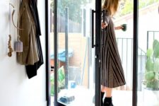 06 a chic black frame glass pivot door makes the entryway more eye-catching and bold