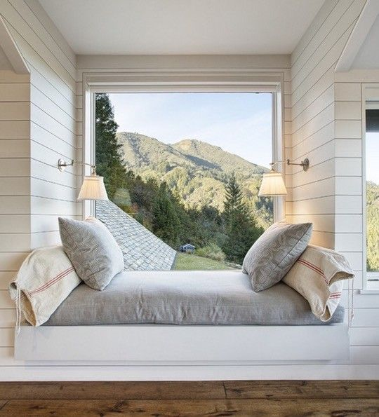 a gorgeous upholstered windowsill with stunning views is comfortable for reading