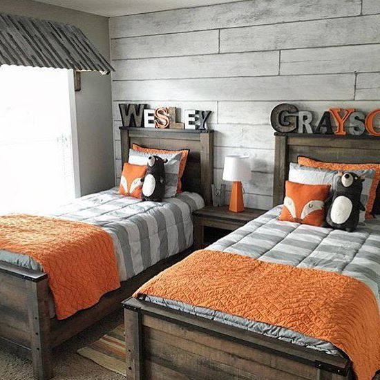 a rustic feel is achieved with reclaimed wood beds, a whitewashed wood wall and nightstands