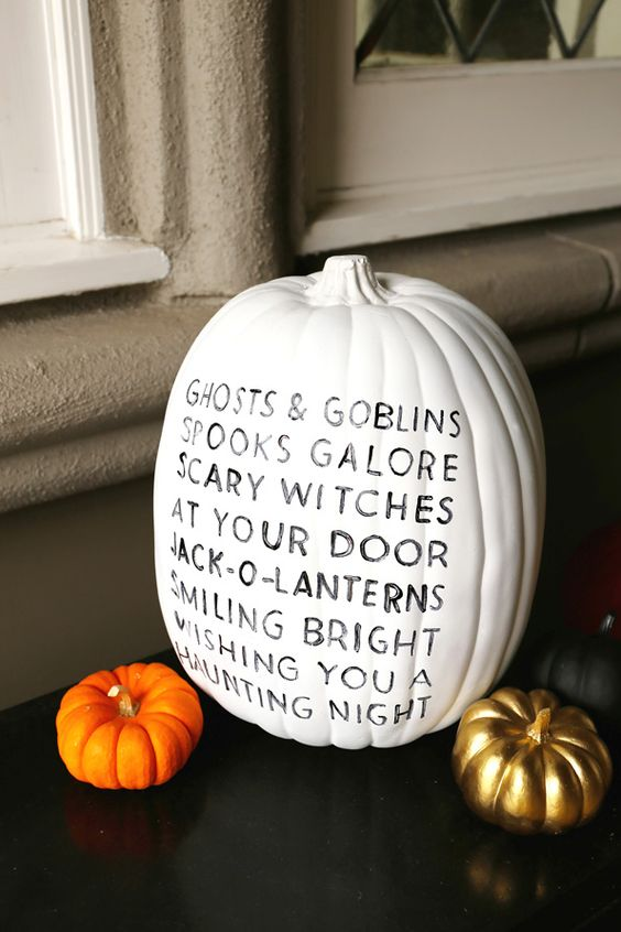 a white pumpkin with black letters for cool modern Halloween decor