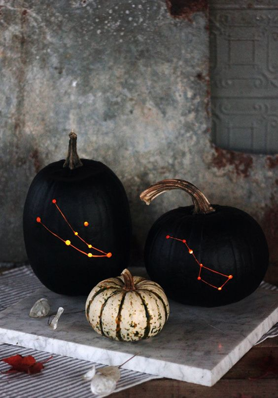 align the stars with these constellation pumpkins made with a drill, black paint, and a chisel
