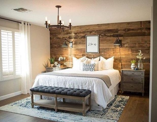 a reclaimed wood wall, wooden nightstands and a bench for a rustic bedroom